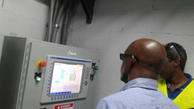 Mr. Earle Kelly, SKMP Managing Director and Mr. Sunil Rangaya, Block Plant Senior Maintenance and Product Supervisor review the newly computerised block making process