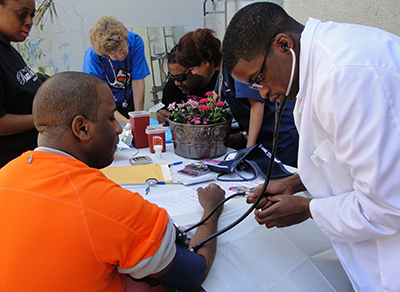 TDC patrons receiving blood sugar and blood pressure checks